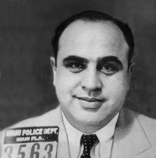 Al Capone was sent to Alcatraz around 1933 for the charge of tax evasion. He was sentenced for 11 years, but only served 7 off good behavior and his deteriorating health.