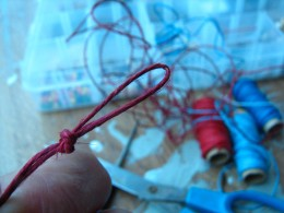 fold the cord in half to make a looped end and tie the knot to leave a loop for the clasping device