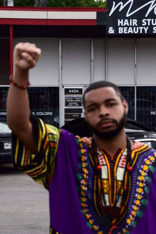 The shooter, Micah Johnson, posted a Facebook picture of himself posing with his black power fist clenched.