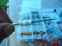 use the bead reamer to clear the holes so the beads are easier to thread