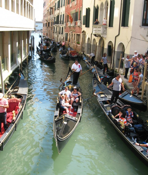 "Gondola rides ""traffic"" in a canal - Venice, Italy."