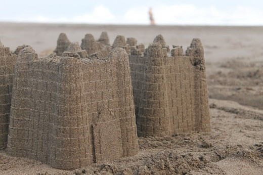 The challenge of building a sandcastle in the sand.