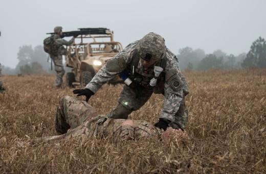 A medical soldier treating casualties in training scenario, 2016.