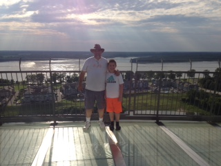My son and I at the top, standing on the glass floors of the observation deck
