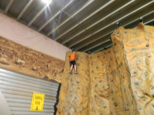Caleb climbing the Mars Wall