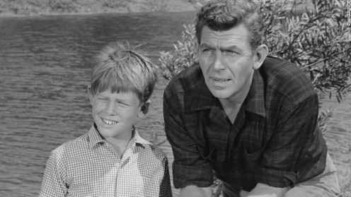 "Ronny Howard as ""Opie,"" and Andy Griffith as ""Andy Taylor"""