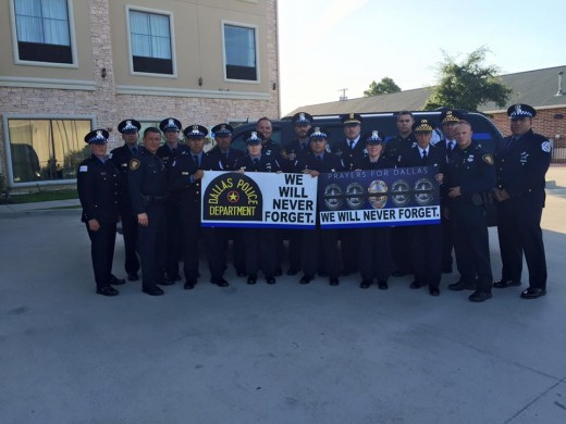 From the Facebook page of Fort Worth Police Department, officers holding a sign in memory of the fallen Dallas PD.