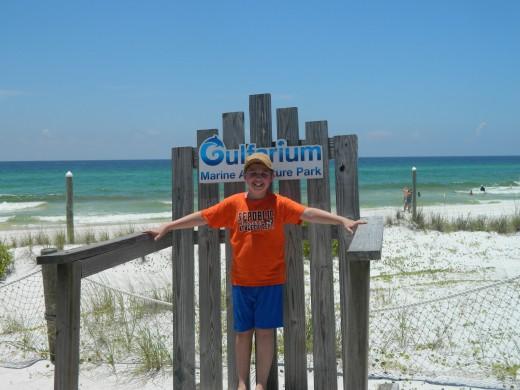 Caleb on the huge chair at the Gulfarium