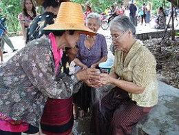 Pouring water over the hands of elders as a form of respect