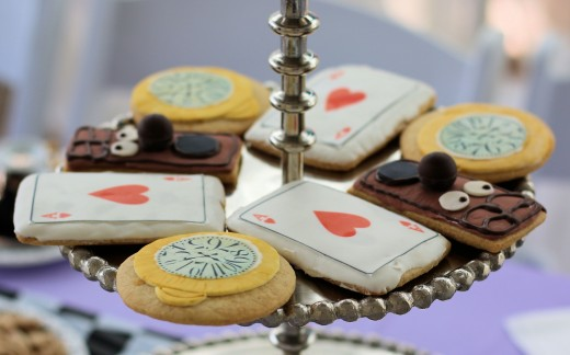 Cookies shaped like playing cards, doorknobs and hand watches.