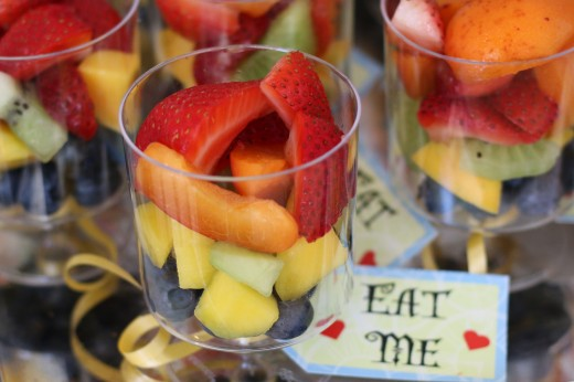 Fruit cups with 'Eat me' tags on them