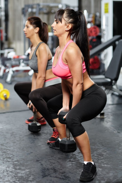 Plie Squats with weight are great for building bigger glutes.