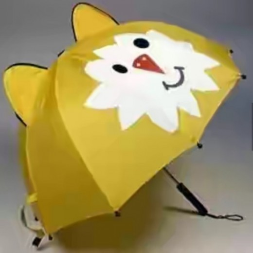 A yellow funny umbrella with a funny face