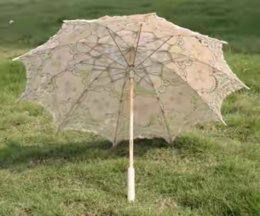 Bridal umbrella with ivory coloured lace