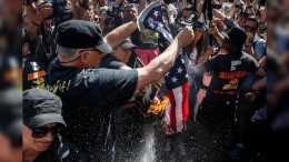 Protesters burn the American Flag in the streets during the 2016 RNC for Donald Trump.