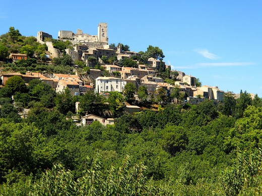 Hillside village of Lacoste with a castle perching on top.