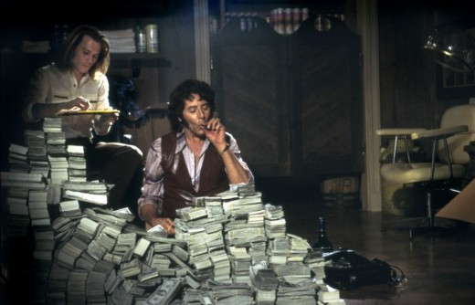 Depp as Jung in a scene where he counts money with Derek