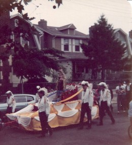 Knights of Columbus taking float down 63rd Street, Brooklyn, NY, 1979.