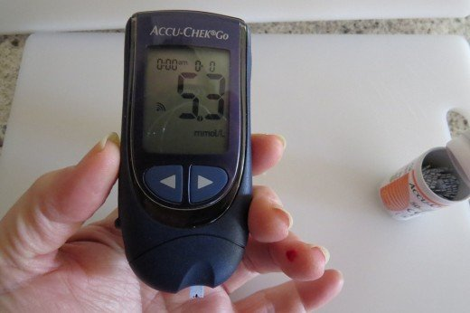 A glucose meter shows a reading of a diabetic's blood sugar level.
