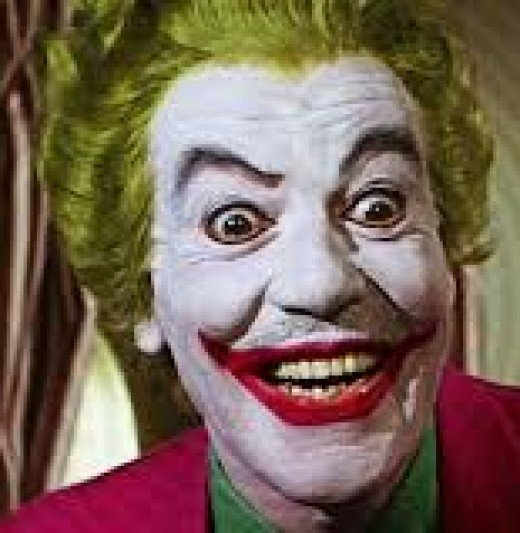 He looks pretty happy. I bet his new Joker Snuggie just arrived on his front porch.