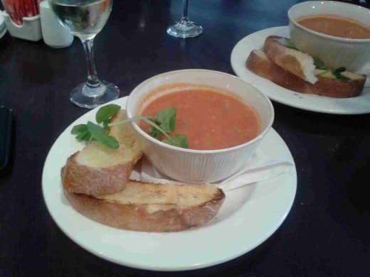 Tomato soup served with garlic bread!