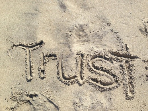 """Umm, i think it's bad idea to wrote 'trust' upon a layer of sand.... uh-oh, here comes the waaaaave!"""