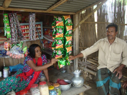 Bhabani with a customer at her shop