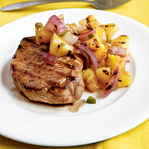 This elegant pork chop entree calls for just a few simple ingredients to make it all taste good. plus the pineapple, onion and pepper salsa complements these chops perfectly.