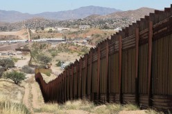 Why are some people angered by Trump's promise to build a wall on the southern border?