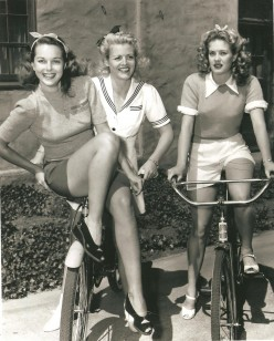 Early photo  of girls with bicycles