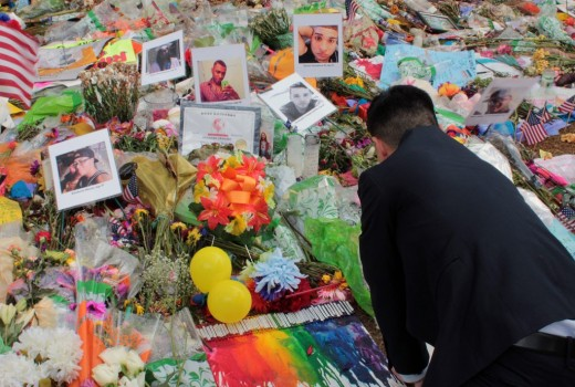 Man visits pulse shooting victims memorial.