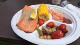 Salmon, corn on the cob, grilled shrimp, grape tomatoes, and three-bean salad at the Steilacoom Salmon Bake