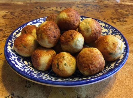 Golden brown Chilli Cheesy Balls immediately after frying.