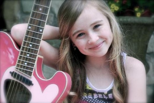 Sabrina Carpenter Posing with her pink Guitar
