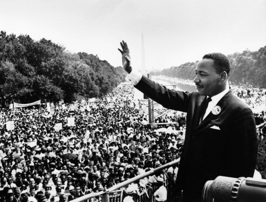 Martin Luther King Waving his hands at thousands awaiting his speech.