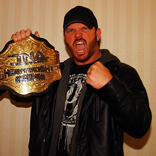 AJ Styles Holding His TNA World Heavyweight Championship with pride