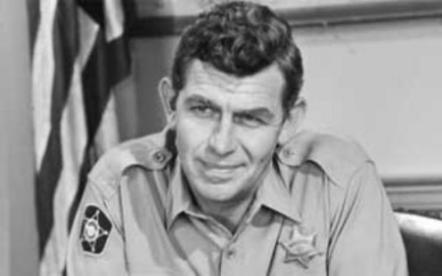 Andy Griffith as  Andy Taylor and tough  taskmaster over the  Andy Griffith Show