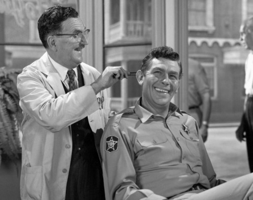 "Howard McNear  as ""Floyd,"" the barber and ""Andy Taylor,""  enjoy a good joke  about Barney"