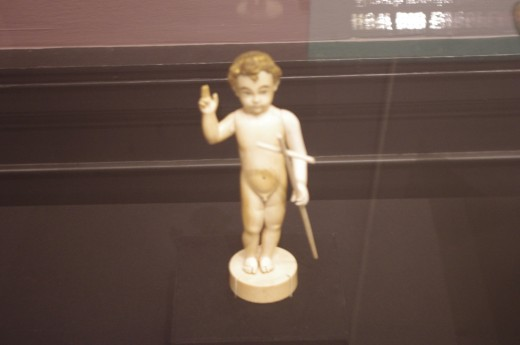 """""""Infant Christ as Savior"""" (17th century). Made of ivory, gilding, and traces of paint. This was most likely brought by the missionaries or """"death bringers"""" depending on your level of pessimism."""