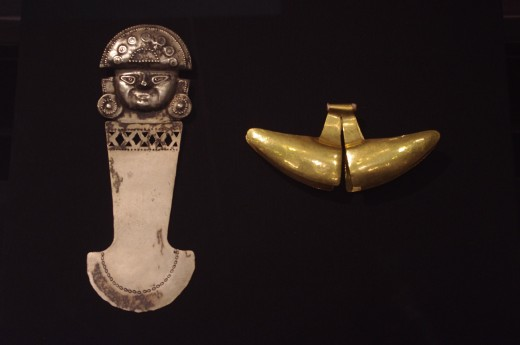 """(left) """"Ceremonial Knife (Tumi)"""" Made of silver alloy. That's a knife? Ok Mr. Walters I'll take your word for it... Not that THAT's worth anything. (left) """"Ornament"""" of Moche (Early Intermediate, 100 BC-600 AD). Made of gold alloy."""
