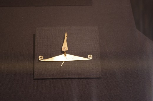 """""""Nose Ornament"""" (Before 1500 AD). Made of gold (hammered sheet, chisel-cut edges, and rolled to create spiraled wire)."""