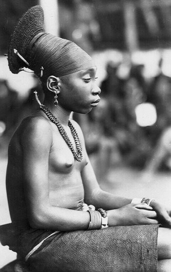 In Africa, a hairstyles's more than just to being fashionable. A person's hairstyle symbolized some one's social rank in the village.