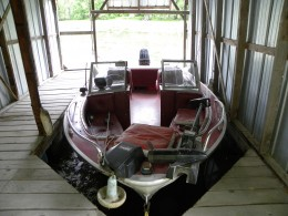 Fishing boat in the boathouse.