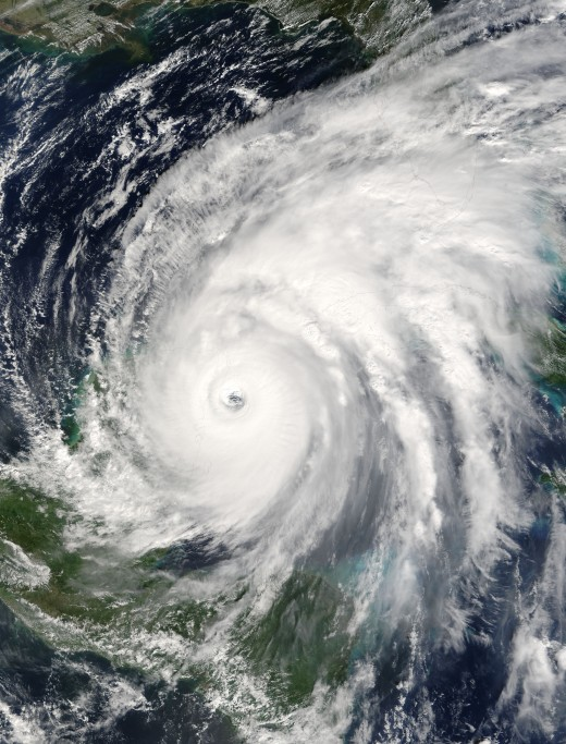 Hurricane Wilma hitting Mexico and its high clouds affecting Florida