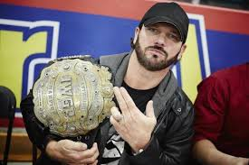 AJ Styles holding his IWGP Championship, becoming one of only a few Americans to hold the Japanese Title.