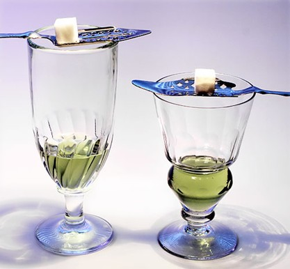 Glass of Absinthe 1914 Absinthe is served this way traditionally. It'€s not a unique configuration. The absinthe is poured through a sugar cube and slotted spoon into the glass. Incredibly alcoholic, it was banned the year after Picasso's work.
