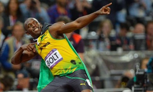Usain Bolt points to his secret (alleged) cell phone stash in the sky.