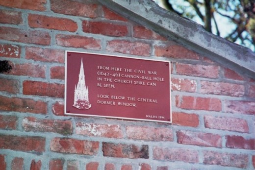 Gaze at the Church spire to discover a hole made by a cannonball. This plaque is on Mount Lane.