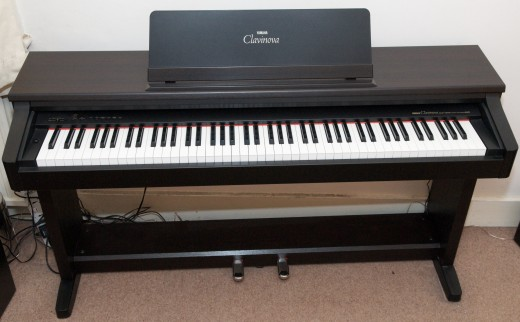 Practice on a digital piano like this rather than on an electronic keyboard.