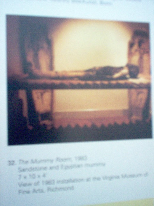 Personal Photo of a Page from the Book 'Atomic Time'.  The photo is of an exhibit titled the Mummy Room.
